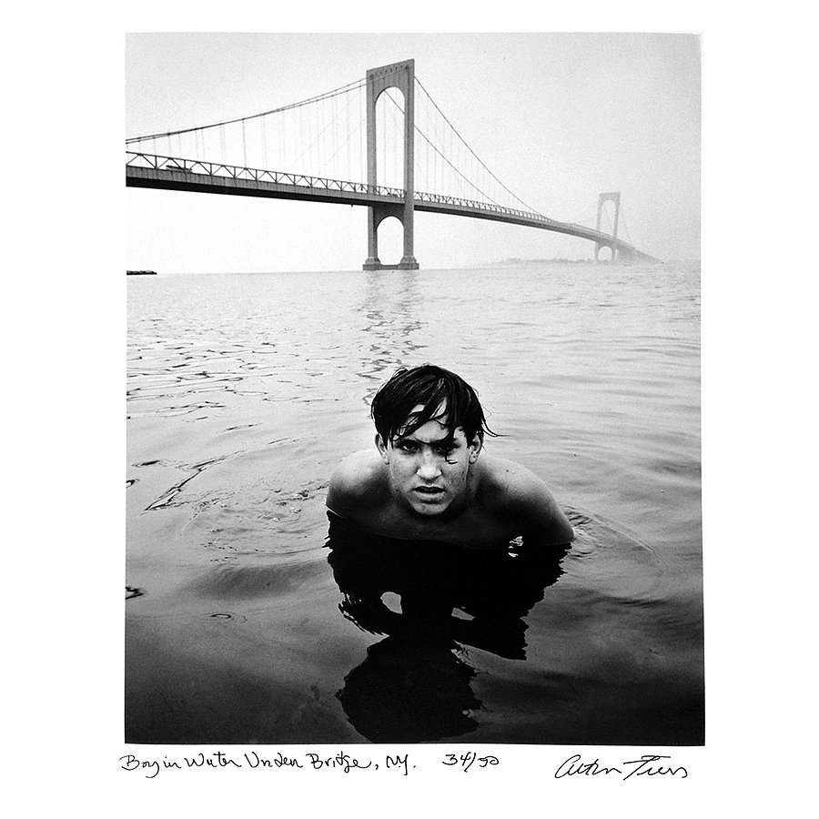 Boy in Water under Bridge